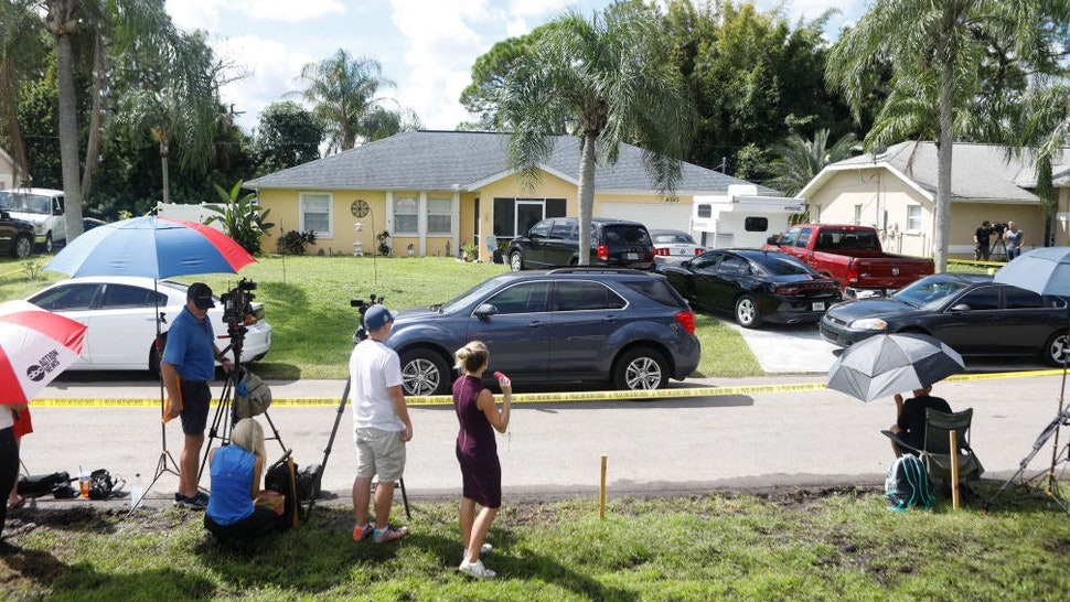 Members of the media wait near the home of Brian Laundrie, who is a person of interest after his fiancé Gabby Petito went missing on September 20, 2021 in North Port, Florida.