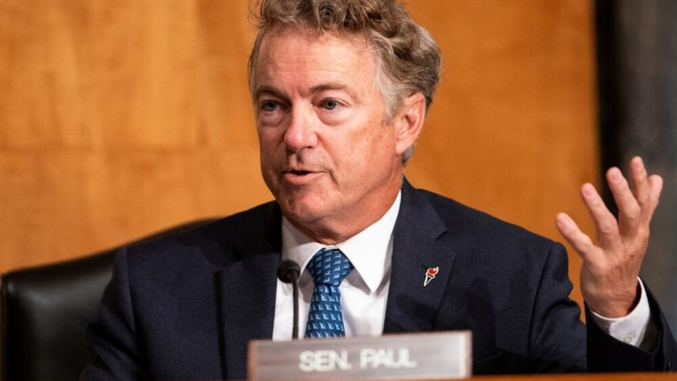 Republican Senator from Kentucky Rand Paul (L) questions FBI Director Christopher Wray during a hearing to discuss security threats 20 years after the 9/11 terrorist attacks, on September 21, 2021, at the US Capitol in Washington, DC.
