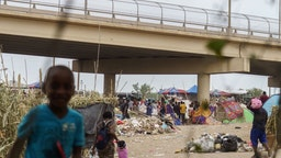 Haitian migrants are pictured in a makeshift encampment where more than 12,000 people hoping to enter the United States await under the international bridge in Del Rio, Texas on September 21, 2021.