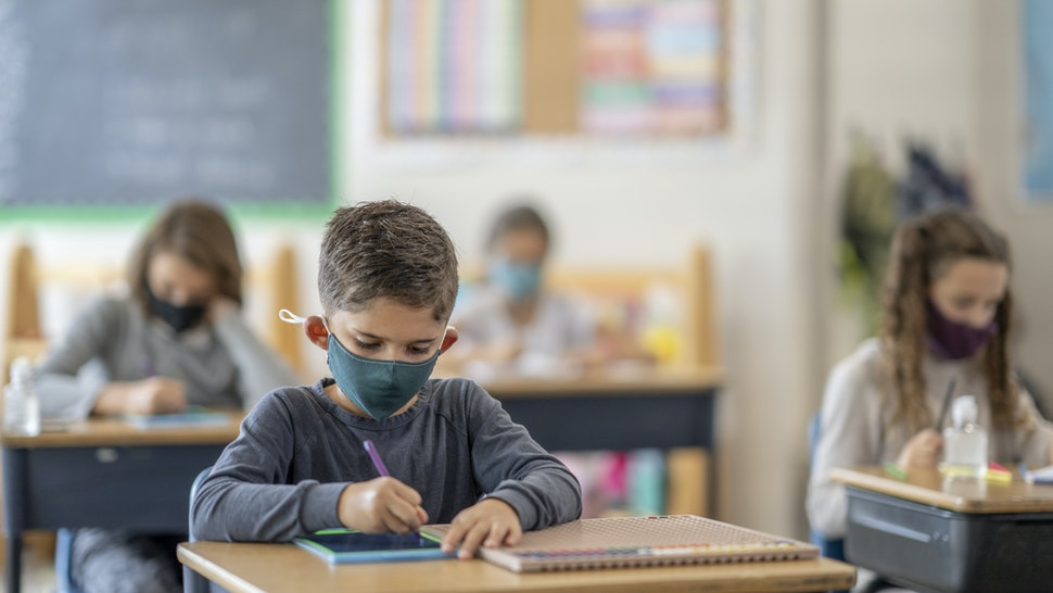 Students wearing masks in class - stock photo
