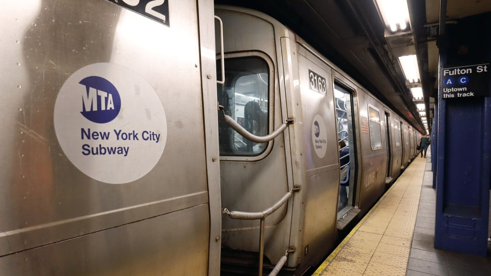 A subway train waits to depart the Fulton St. station on June 16, 2021 in New York City.
