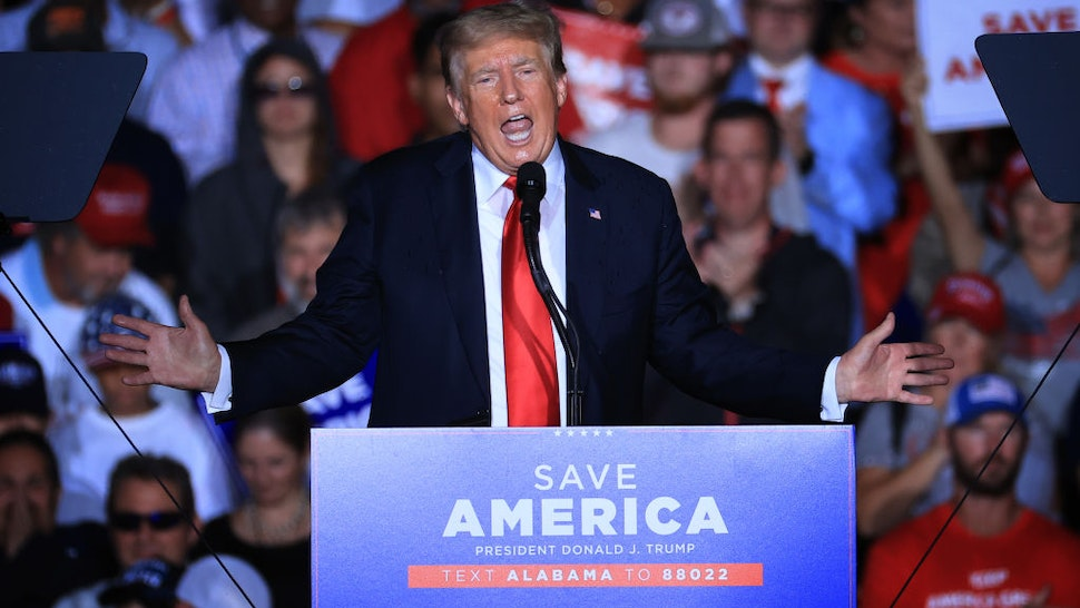 """Former U.S. President Donald Trump addresses supporters during a """"Save America"""" rally at York Family Farms on August 21, 2021 in Cullman, Alabama"""