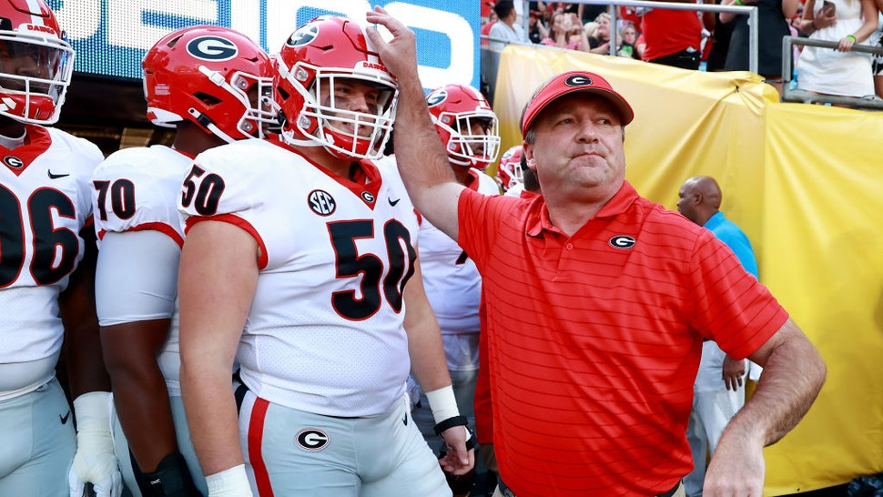 CHARLOTTE, NORTH CAROLINA - SEPTEMBER 04: Head coach Kirby Smart of the Georgia Bulldogs leads his team onto the field before their game against the Clemson Tigers in the Duke's Mayo Classic at Bank of America Stadium on September 04, 2021 in Charlotte, North Carolina. (Photo by Grant Halverson/Getty Images)