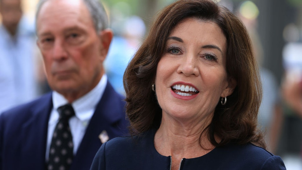 New York Gov. Kathy Hochul (R) and former New York City Mayor Mike Bloomberg talk to reporters after laying flowers at the south memorial pool to commemorate the 20th anniversary of the September 11 terror attack at the 9/11 Memorial and Museum on September 08, 2021 in New York City.