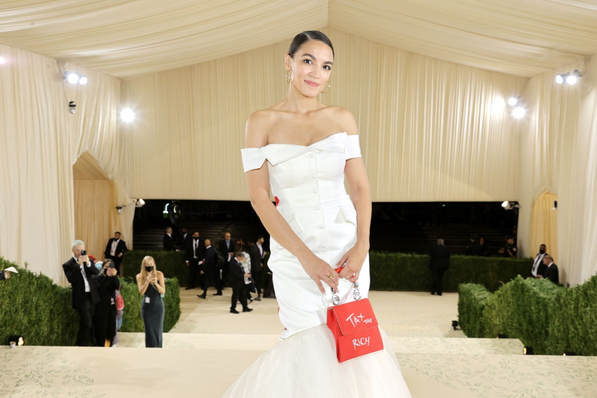 WATCH: Masked Attendants Carry Unmasked AOC's 'Tax The Rich' Dress As She Leaves Met Gala