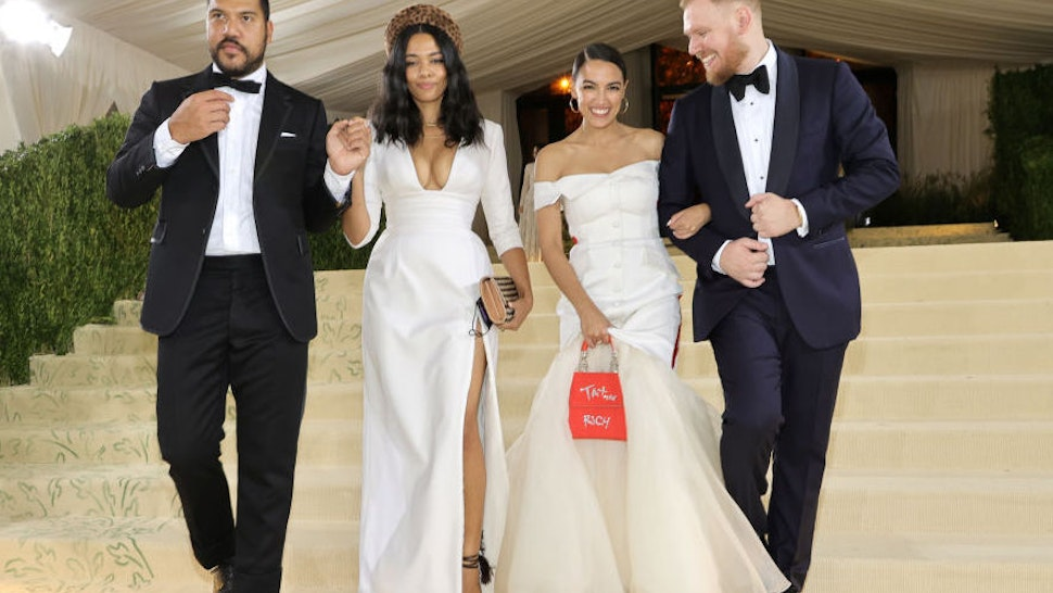 Benjamin Bronfman, Aurora James, Alexandria Ocasio-Cortez and Riley Roberts depart The 2021 Met Gala Celebrating In America: A Lexicon Of Fashion at Metropolitan Museum of Art on September 13, 2021 in New York City.