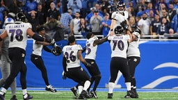 DETROIT, MICHIGAN - SEPTEMBER 26: Justin Tucker #9 of the Baltimore Ravens celebrates the winning field goal with his team in the game against the Detroit Lions at Ford Field on September 26, 2021 in Detroit, Michigan. (Photo by Nic Antaya/Getty Images)