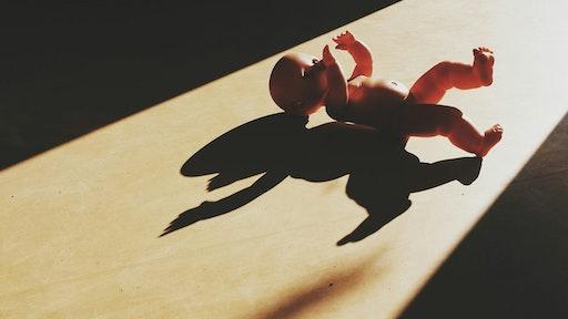 High Angle View Of Baby Toy On Hardwood Floor