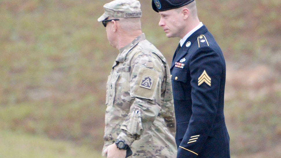 FORT BRAGG, NC - OCTOBER 23: U.S. Army Sgt. Robert Bowdrie 'Bowe Bergdahl' (R), 31 of Hailey, Idaho, is escorted into the Ft. Bragg military courthouse for his sentencing hearing on October 23, 2017 in Fort Bragg, North Carolina. Bergdahl pled guilty to desertion and misbehavior of in front of the enemy stemming from his decision to leave his outpost in 2009, which landed him five years in Taliban captivity. (Photo by Sara D. Davis/Getty Images)