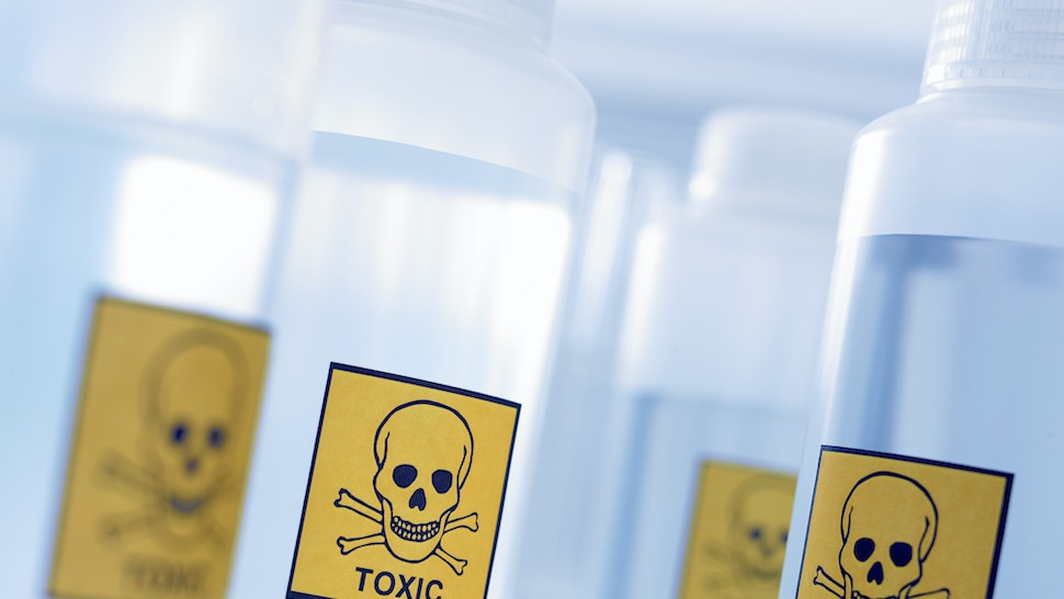 Bottles with toxic labels - stock photo