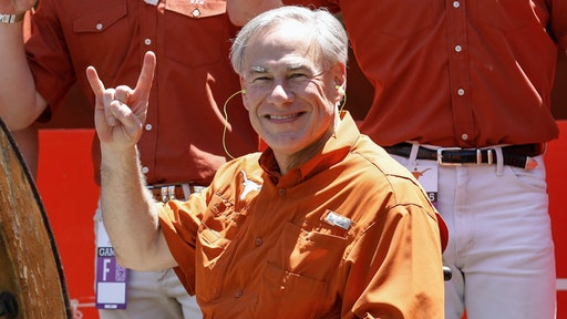 AUSTIN, TEXAS - APRIL 24: Texas Governor Greg Abbott poses for a photo with members of the Silver Spurs during the Texas Football Orange-White Spring Game at Darrell K Royal-Texas Memorial Stadium on April 24, 2021 in Austin, Texas.