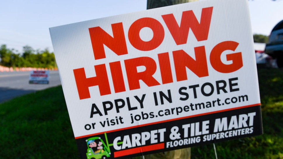 """Muhlenberg, PA - August 26: A help wanted sign that reads """"Now Hiring, Apply In Store"""" outside the Carpet and Tile Mart along 5th Street Highway in Muhlenberg Twp. Thursday morning August 26, 2021. (Photo by Ben Hasty/MediaNews Group/Reading Eagle via Getty Images)"""