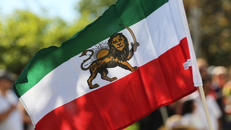 Iranian flag seen during the first ever Persian parade in Toronto, Ontario, Canada, on August 31, 2019. The parade showcased traditional costumes that illustrated the diverse cultural traditions and history of Iran.