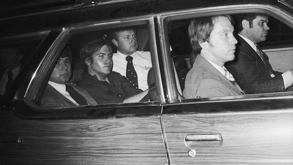 4/10/81-Washington, DC: John Hinckley, Jr. (center), the man charged with the attempted murder of President Reagan, now finds himself the center of Federal protection, March 30th, as he is driven away from U.S. District Court. Hinckley was seated in the center seat of a nine-seat section station with agents assigned to protect him, seated in front, alongside, and behind him. Ph: John Full