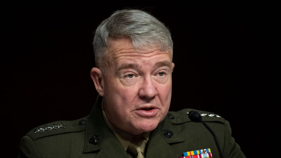 """UNITED STATES - April 22: Marine Corps Gen. Kenneth McKenzie Jr., commander of the U.S. Central Command testifies before the Senate Armed Services Committee during its hearing on the """"U.S. Central Command and U.S. Africa Command in review of the Defense Authorization Request for FY2022 and the Future Years Defense Program in Washington on Thursday, April 22, 2021. (Photo by Caroline Brehman/CQ-Roll Call, Inc via Getty Images)"""
