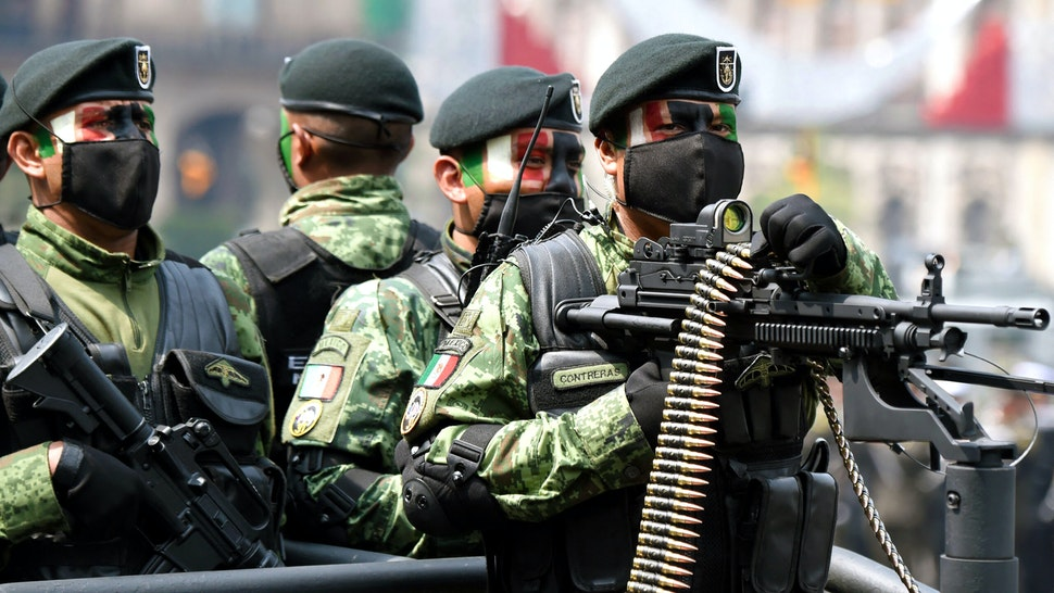 Soldiers of the Mexican Army take part in the military parade for the 211th anniversary of the Independence Day at the Zocalo Square in Mexico City on September 16, 2021.
