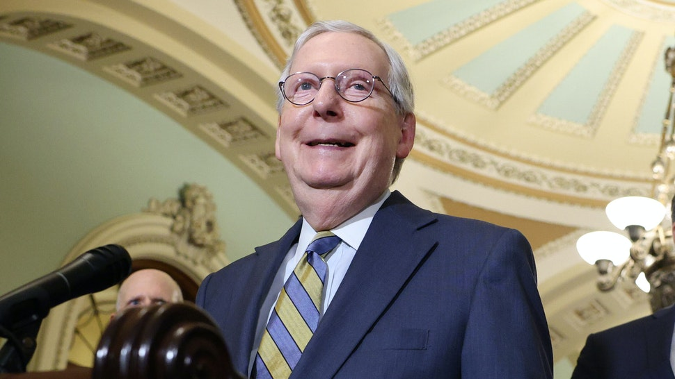 WASHINGTON, DC - AUGUST 03: Senate Minority Leader Mitch McConnell smiles before speaking at a news conference following a policy luncheon at the Capitol Building on August 3, 2021 in Washington, DC. Leader McConnell expressed his wish that Senate Majority Leader Chuck Schumer (D-NY) not file cloture to end amendment debate on the Senate Infrastructure bill to allow more time for members to read the text of the bill.