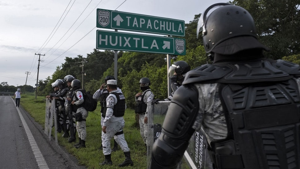 Members of The National Guard block a street during an operation to dissolve a caravan of Central American and Haitian migrants heading to the US, in Huixtla, Chiapas state, Mexico, on September 5, 2021.