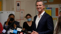 OAKLAND, CALIFORNIA - SEPTEMBER 15: Gov. Gavin Newsom speaks to the press while visiting Melrose Leadership Academy in Oakland, Calif., on Wednesday, Sept. 15, 2021. On Tuesday, Newsom prevailed in the California Gubernatorial Recall Election to keep his post as governor.