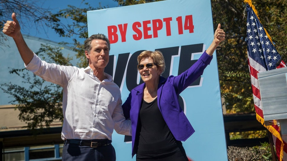 """CULVER CITY, CA - SEPTEMBER 04: California Gov. Gavin Newsom and Sen. Elizabeth Warren (D-MA) take to the stage at a """"Stop the Republican Recall"""" rally at Culver City High School on September 4 in Culver City, California."""