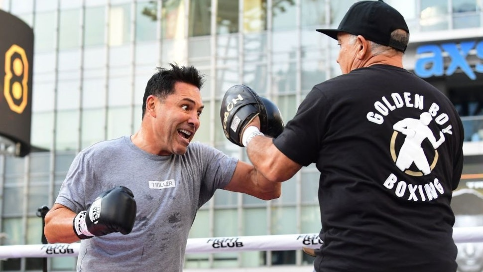 Former US Olympics Gold medalist professional boxer Oscar De La Hoya (L) spars with his partner during a public media workout in Los Angeles, California on August 24, 2021.