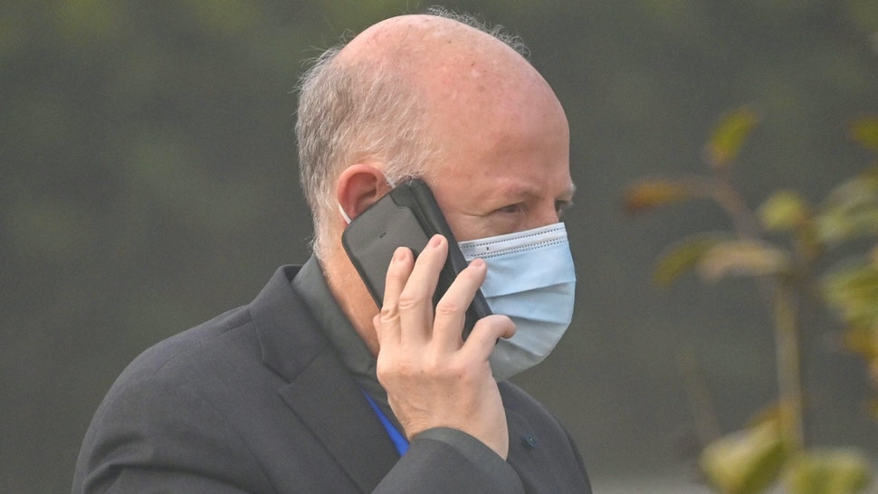Peter Daszak, a member of the World Health Organization (WHO) team investigating the origins of the COVID-19 coronavirus, talks on his cellphone at the Hilton Wuhan Optics Valley in Wuhan, in China's central Hubei province on February 3, 2021.