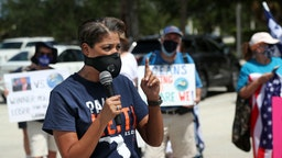 Congressional candidate Pam Keith, who is running against Rep. Brian Mast, speaks to anti-Trump protesters at Burt Reynolds Park in Jupiter, Florida on Tuesday, Sept. 8, 2020. President Donald Trump made an appearance at the Jupiter Inlet Lighthouse touting his environmental policies and announcing he's extending the moratorium on offshore oil drilling in Florida.