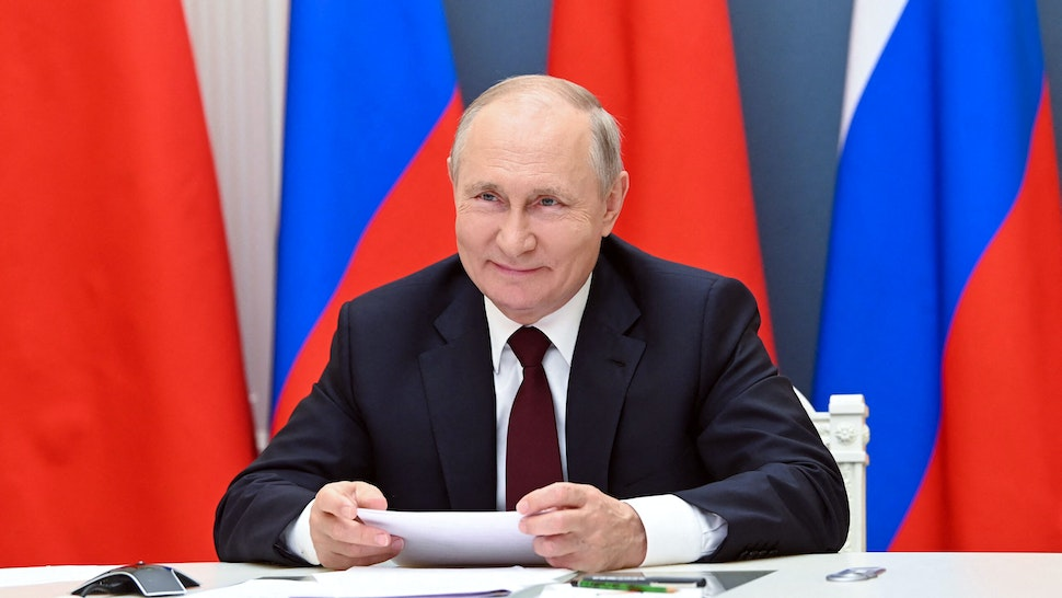 Russian President Vladimir Putin holds a meeting via video conference with Chinese President Xi Jinping (not seeen) at the Kremlin in Moscow on June 28, 2021.
