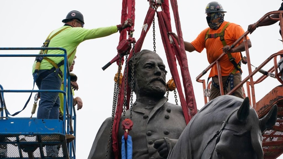 RICHMOND, VIRGINIA - SEPTEMBER 08: Crews prepare to remove one of the country's largest remaining monuments to the Confederacy, a towering statue of Confederate General Robert E. Lee on Monument Avenue, September 8, 2021 in Richmond, Virginia. The Commonwealth of Virginia is removing the largest Confederate statue remaining in the U.S. following authorization by all three branches of state government, including a unanimous decision by the Supreme Court of Virginia. September 8, 2021 in Richmond, Virginia. The Commonwealth of Virginia is removing the largest Confederate statue remaining in the U.S. following authorization by all three branches of state government, including a unanimous decision by the Supreme Court of Virginia.