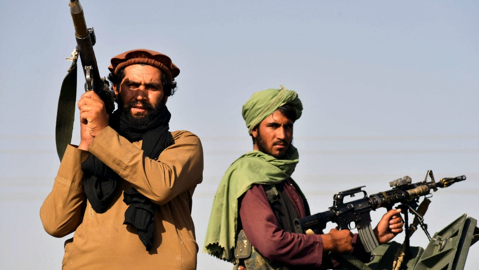 Taliban fighters stand on an armoured vehicle before parading along a road to celebrate after the US pulled all its troops out of Afghanistan, in Kandahar on September 1, 2021 following the Talibans military takeover of the country.
