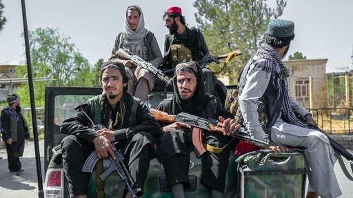 Members of the Taliban drive in the Pul-e-Charkhi prison in Kabul on September 16, 2021.