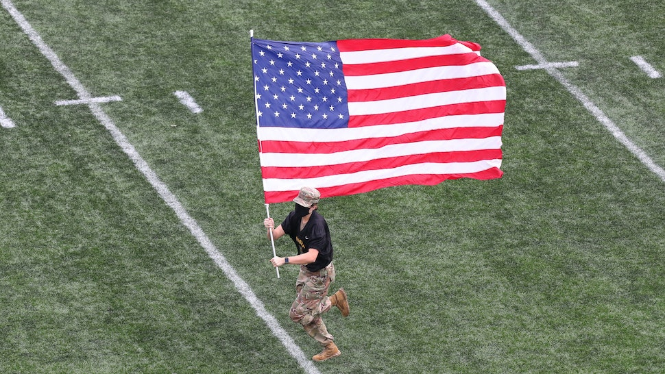 WEST POINT, NY - NOVEMBER 21: An Army Cadet carries the American Flag on the filed prior to the game against the Georgia Southern Eagles at Michie Stadium on November 21, 2020 in West Point, New York.