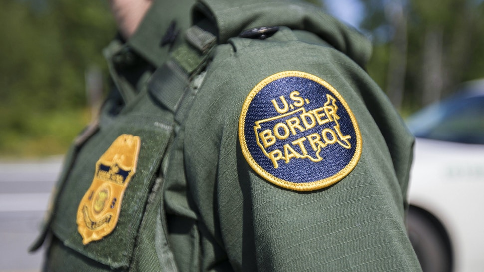 WEST ENFIELD, ME - AUGUST 01: A patch on the uniform of a U.S. Border Patrol agent at a highway checkpoint on August 1, 2018 in West Enfield, Maine. The checkpoint took place approximately 80 miles from the US/Canada border.
