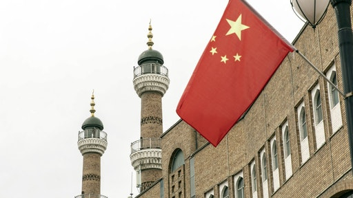 A Chinese national flag outside the Xinjiang International Grand Bazaar in Urumqi, Xinjiang province, China, on Wednesday, May 12, 2021. China has told nations criticizing its policies inXinjiangto stop interfering in domestic affairs.