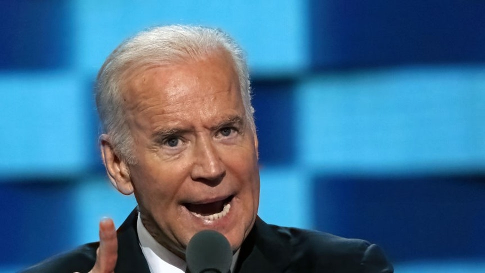 """President Joseph """"Joe"""" Biden addresses the delegates from the podium during the 3rd day of the Democratic National Nominating Convention in the Wells Fargo arena (Photo by"""
