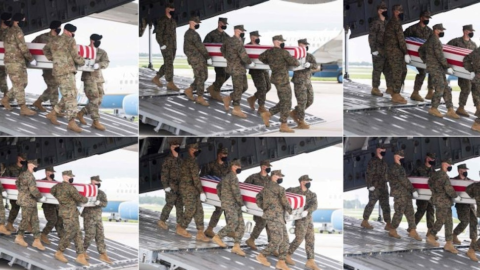 (COMBO) Military transfer teams carry one of 11 flag-draped transfer cases with the remains of a member of the military killed last week in Afghanistan off a military aircraft as US President Joe Biden attends the dignified transfer at Dover Air Force Base in Dover, Delaware, August, 29, 2021. - (From L-R, top to bottom row) The 11 service members include Army Staff Sgt. Ryan C. Knauss, 23, of Corryton, Tennessee; Marine Corps Staff Sgt. Darin T. Hoover, 31, of Salt Lake City, Utah; Marine Corps Sgt. Johanny Rosariopichardo, 25, of Lawrence, Massachusetts; Marine Corps Sgt. Nicole L. Gee, 23, of Sacramento, California; Marine Corps Cpl. Daegan W. Page, 23, of Omaha, Nebraska; Marine Corps Cpl. Humberto A. Sanchez, 22, of Logansport, Indiana; Marine Corps Lance Cpl. David L. Espinoza, 20, of Rio Bravo, Texas; Marine Corps Lance Cpl. Jared M. Schmitz, 20, of St. Charles, Missouri; Marine Corps Lance Cpl. Dylan R. Merola, 20, of Rancho Cucamonga, California; Marine Corps Lance Cpl. Kareem M. Nikoui, 20, of Norco, California; and Navy Hospitalman Maxton W. Soviak, 22, of Berlin Heights, Ohio. The transfer cases with the remains of two additional service members are not pictured. Dover Air Force Base in Delaware on the US East Coast about two hours from Washington is synonymous with the painful return of service members who have fallen in combat. (Photo by SAUL LOEB / AFP) (Photo by