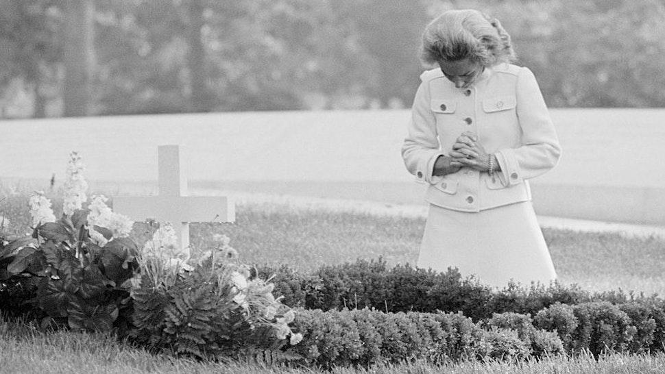 Ethel Kennedy Kneeling at Husband Robert F. Kennedy Gravesite