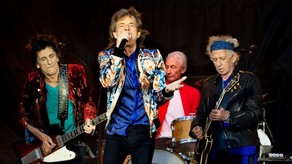 MANCHESTER, ENGLAND - JUNE 05: Mick Jagger, Keith Richards, Charlie Watts and Ronnie Wood of The Rolling Stones perform live on stage at Old Trafford on June 5, 2018 in Manchester, England. (Photo by