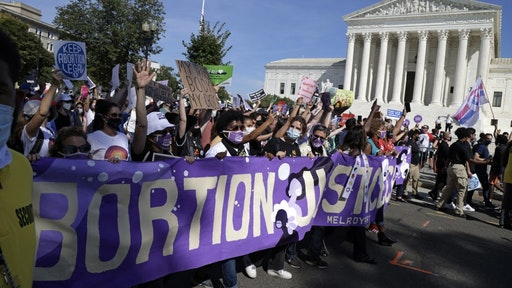Marches Held Nationwide In Support Of Reproductive Rights WASHINGTON, DC - OCTOBER 02: Women rights activists participate in the annual Women's March as they pass by the U.S. Supreme Court October 2, 2021 in Washington, DC. The annual march returns to Washington for the fifth time with a focus on fighting for abortion rights. (Photo by Alex Wong/Getty Images) Alex Wong / Staff via Getty Images