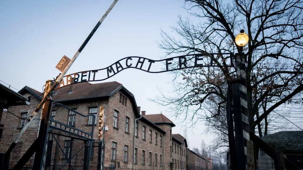 """Auschwitz-Birkenau before the 75th anniversary of the liberation 24 January 2020, Poland, Oswiecim: The lettering """"Arbeit macht frei"""" can be seen at the gate to the former concentration camp Auschwitz I. 27.01.2020 marks the 75th anniversary of the liberation of the concentration camp by the Red Army. From 1940 to 1945, the SS operated the complex with numerous satellite camps as concentration and extermination camps. The number of those murdered amounts to 1.1 to 1.5 million, most of them Jews. Auschwitz stands as a symbol of industrial mass murder and the extermination of the Jews. Photo: Kay Nietfeld/dpa (Photo by Kay Nietfeld/picture alliance via Getty Images) picture alliance / Contributor"""