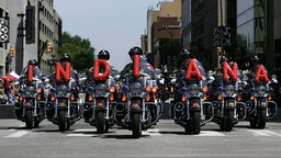 Indianapolis 500 Parade INDIANAPOLIS - MAY 24: State troopers on motorcycles perform during the parade for the IRL IndyCar Series 92nd running of the Indianapolis 500 May 24, 2008 in Indianapolis, Indiana. (Photo by Robert Laberge/Getty Images) Robert Laberge / Stringer
