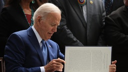U.S. President Joe Biden signs proclamations expanding the areas of three national monuments at the White House on October 08, 2021 in Washington, DC.