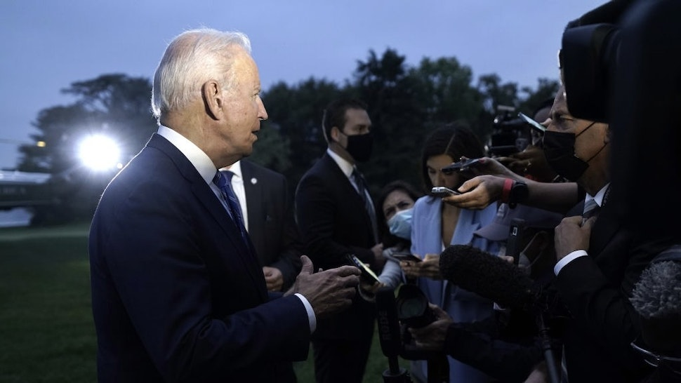 President Biden Travels To Michigan U.S. President Joe Biden speaks to members of the media on the South Lawn of the White House after arriving on Marine One in Washington, D.C., U.S., on Tuesday, Oct. 5, 2021. Bidensought to shore up support for his economic agenda among centrist lawmakers with a trip to Michigan today, with disagreements among Democratic factions stalling key measures on infrastructure and social programs.Photographer: Yuri Gripas/Abaca/Bloomberg via Getty Images Bloomberg / Contributor