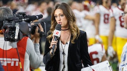 ESPN sideline reporter Allison Williams talk to the camera on the sideline during the Cotton Bowl Classic matchup between the USC Trojans and Ohio State Buckeyes on December 29, 2017, at the AT&T Stadium in Arlington, TX.