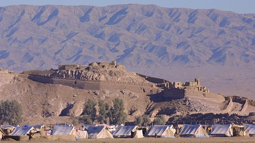 AFGHANISTAN - DECEMBER 01: Kandahar Road On January 12Th, 2001, Afghanistan. Afghan Refugee Camp Near The City Of Spin Boldak. In The Background, Pakistan Mountains.