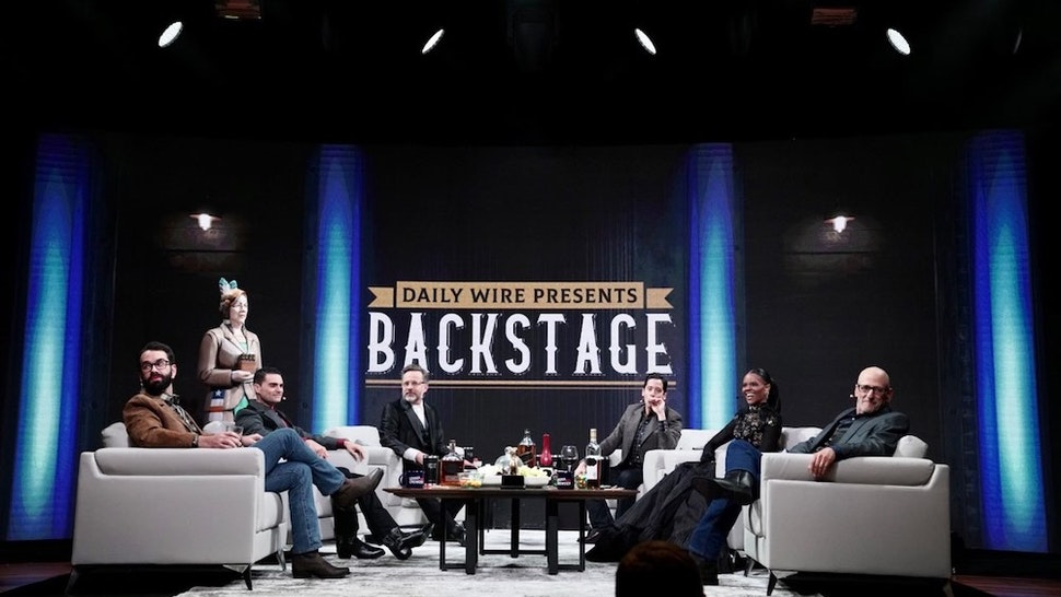 """October 12: (L-R) The Daily Wire's Matt Walsh, Ben Shapiro, Jeremy Boreing, Michael Knowles, Candace Owens, and Andrew Klavan appear live at the Ryman Auditorium in Nashville for """"Backstage Live at the Ryman."""" (Credit: The Daily Wire)"""