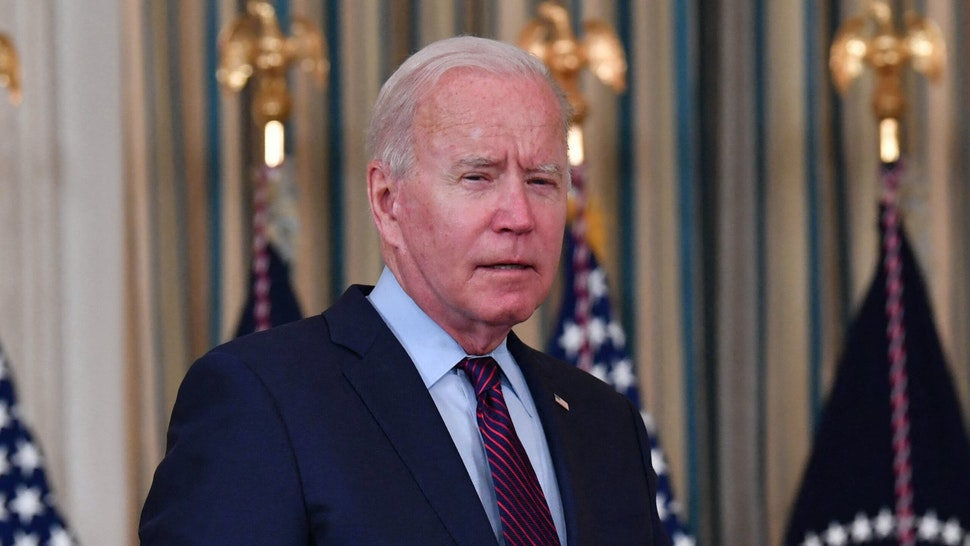 """US President Joe Biden arrives to deliver remarks on the debt ceiling from the State Dining Room of the White House on October 4, 2021 in Washington, DC. - President Joe Biden on Monday called Republican opponents """"reckless and dangerous"""" for refusing to join Democrats in raising the US debt limit, putting the world's biggest country at risk of imminent default."""