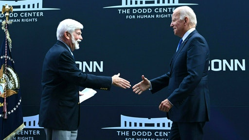 Former US Senator Chris Dodd (D-CT) greets US President Joe Biden (R) at the dedication of the Dodd Center for Human Rights at the University of Connecticut on October 15, 2021 in Storrs, Connecticut.