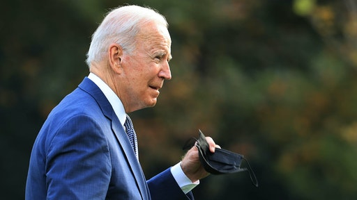 WASHINGTON, DC - OCTOBER 25: U.S. President Joe Biden walks across the South Lawn after returning to the White House on October 25, 2021 in Washington, DC. Biden spent the weekend at his home in Delaware and then traveled to New Jersey where he visited an elementary school and a transit center earlier on Monday to talk about his Build Back Better plan.