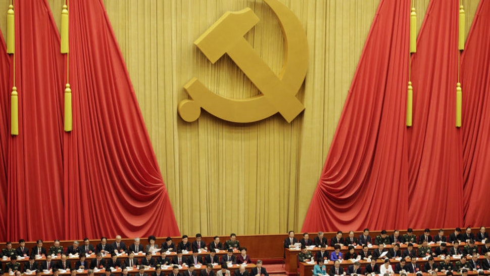 """Delegates attend the opening of the 19th National Congress of the Communist Party of China at the Great Hall of the People in Beijing, China, on Wednesday, Oct. 18, 2017. Xi warned of """"severe"""" challenges, as he kicked off a twice-a-decade party meeting that may signal if he will appoint a successor to rule after 2022."""